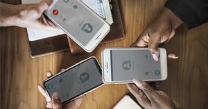 three people sharing their contact information wirelessly using their cell phones